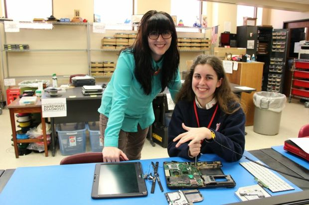 Colette Burke, SJA Help Desk Manager, and a student at the SJA Technology Repair Center in Baton Rouge