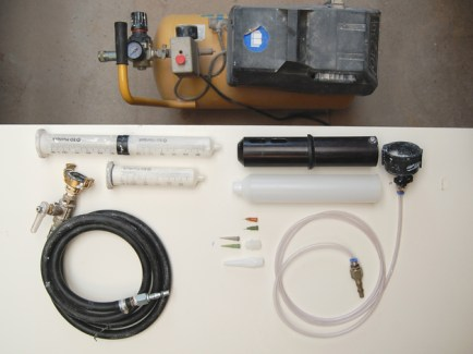 Johnathan's clay 'Extruder', complete with air compressor and Techcon TS series dispensing gun parts
