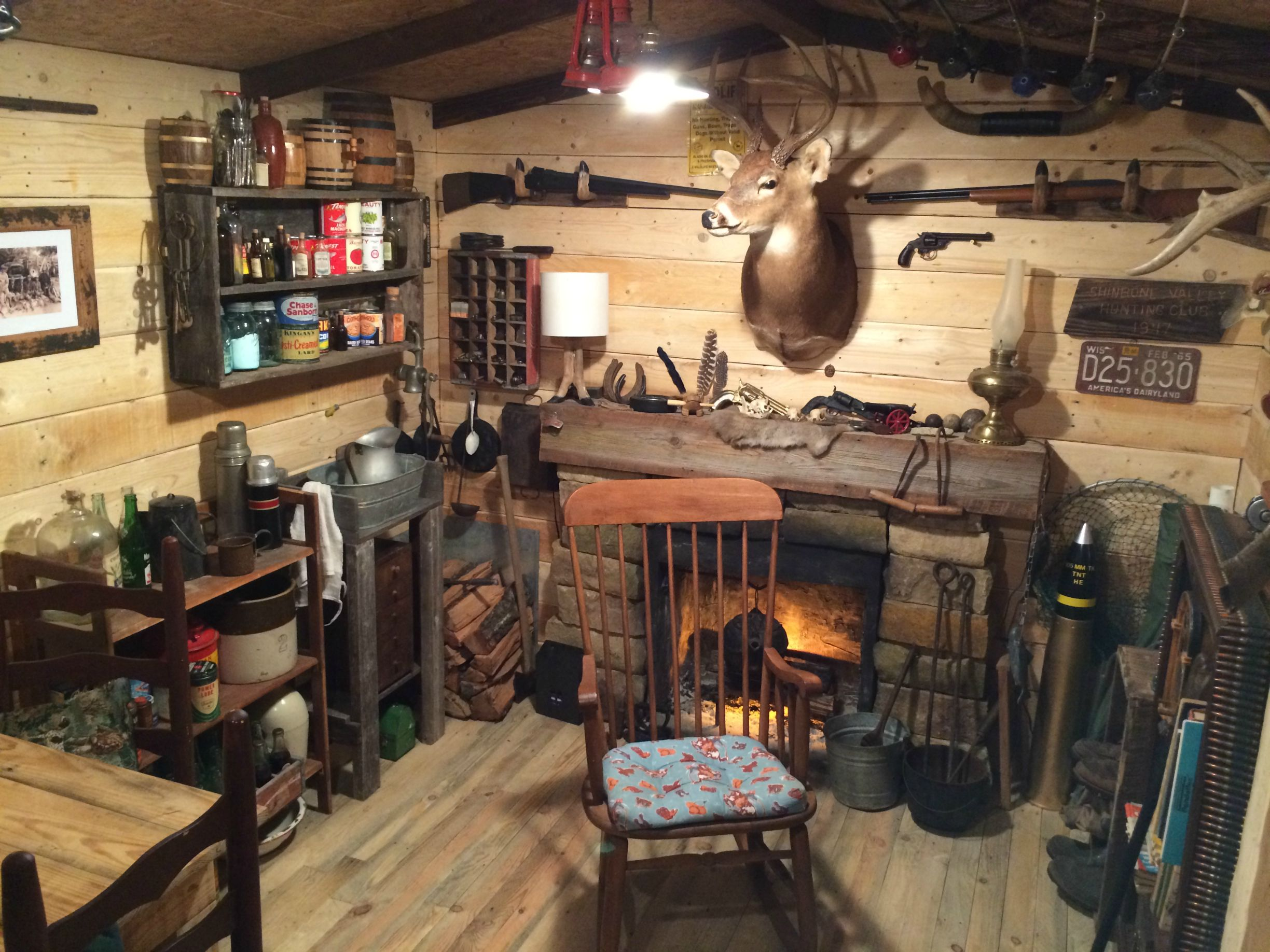 Man turns unused basement room into a log cabin replica for Log cabin with basement