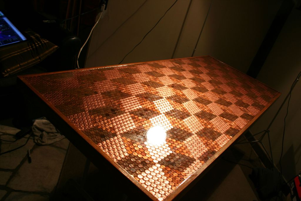 This tabletop has over 5000 pennies embedded in it make for Copper penny bar top