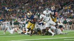 Sr. Tarean Folston evades a tackle from Michigan State's denfense