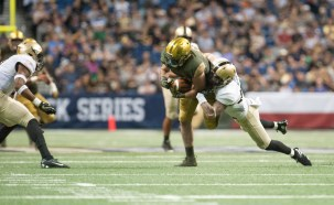 Nic Weishar tries to stay on his feet versus Army on Saturday.