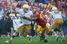 Irish junior quarterback DeShone Kizer attempts to elude a pass rusher during Notre Dame's 45-27 loss Saturday to USC.