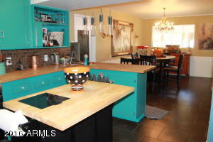 Country kitchen with moveable island, breakfast bar opens to breakfast nook.