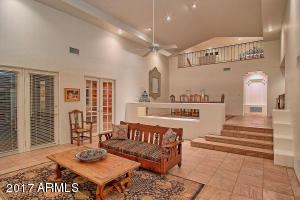 """Beautiful 16"""" Flagstone tile in all main living areas, this home has many unique architectural detail that make it something special, ceiling details in every room, niches and custom shelving to display artwork or pictures."""