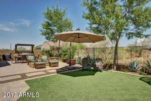 Synthetic grass adds to this low maintenance backyard