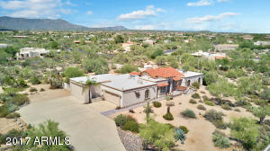 Located on an elevated acre+ lot