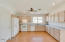 Great neutral flooring in kitchen and flows into great room