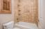 bath room with stone shower