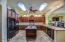 Kitchen offers enhanced custom lighting.