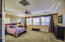 Master bedroom offers Tray Ceiling and double doors.
