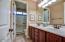 Bathroom #4 offers double sinks, raised vanities, linen closet and separate door to the shower/toilet room.