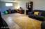 HUGE downstairs area can be your master suite with attached bath and carpeted seating area, or..