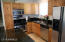 Kitchen updated with SS Gas stove, built-in microwave, dishwasher and SS side-by-side fridge.
