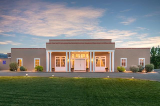 Traditional New Mexico Territorial design showcasing brick coping, custom millwork, capitals and bases.