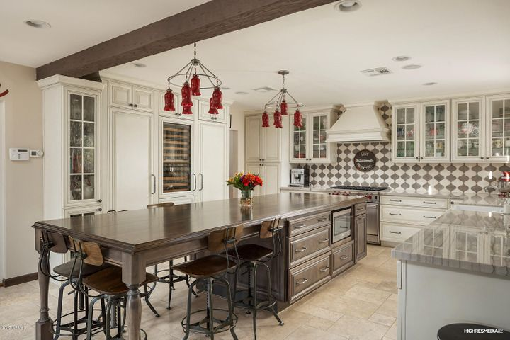 The kitchen was completely remodeled, mixing contemporary amenities without compromising the historical feel of the home. The kitchen includes two paneled Bosch dishwashers, a Wolf stove/oven, a paneled Sub-Zero refrigerator, freezer, four refrigerator drawers and wine refrigerator