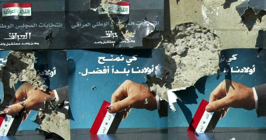 Posters invite Iraqis to participate in a general election