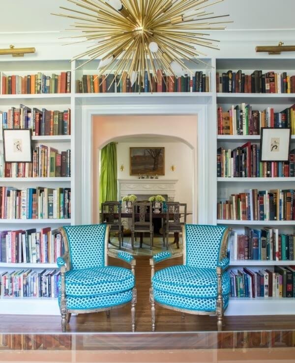 Bookshelves custom-built by RKA Investments hold the family's extensive collection of books.