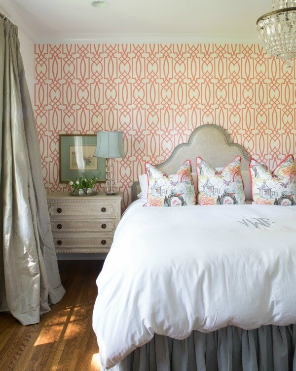 One wall in the guest bedroom features a bold, trellised wallpaper, bringing punch to the space and creating a fun retreat for guests.