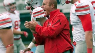 Stony Brook football coach Chuck Priore applauds his players as they warm up for an NCAA college football game against Maine in Orono, Maine, Saturday, Nov. 2, 2013. (AP Photo/Michael C. York)