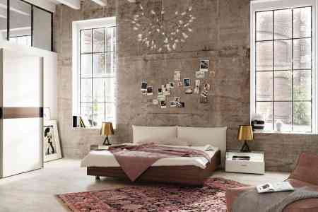 modern bedroom design with a distressed wall hulsta harmony
