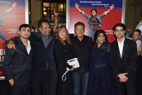 "Actor Aaron Phagura, British writer Sarfraz Manzoor, guitarist Patti Scialfa with her husband singer-songwriter Bruce Springsteen, Director Gurinder Chadha and actor Viveik Kalra attend the premiere of ""Blinded by the Light"" at Paramount Theater on August"