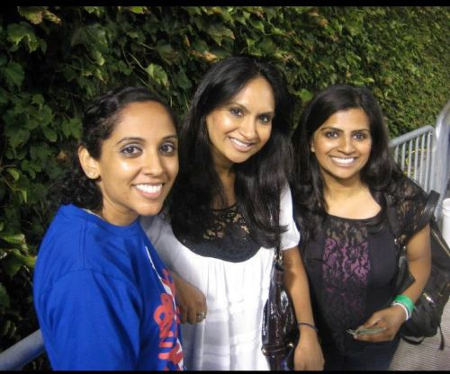 The author [center] with her younger sister Almas [right] and friend Deba Malik at Bruce Springsteen's 2012 concert at Wrigley Field.