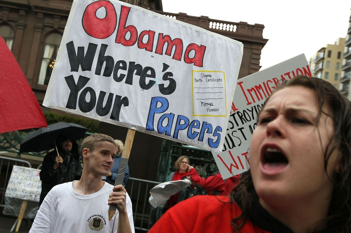 A Tea Party supporter holds a sign asking