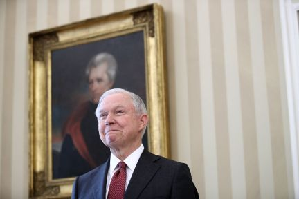 Jeff Sessions listens as President Donald Trump introduces him prior to being sworn in as the new U.S. Attorney General in the Oval Office of the White House February 9, 2017 in Washington, D.C. (Photo by Win McNamee/Getty Images)