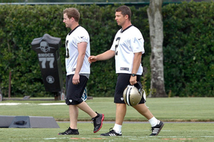 June 5, 2012; Metairie, LA, USA; New Orleans Saints place kicker John Kasay (2) and place kicker Garrett Hartley (5) walk on the field during a minicamp session at the team's practice facility. Mandatory Credit: Derick E. Hingle-US PRESSWIRE