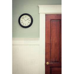 Small Crop Of Clock On Wall