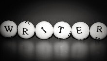 """Black & white image of letters on 5 small balls that spell out the word """"writer"""""""