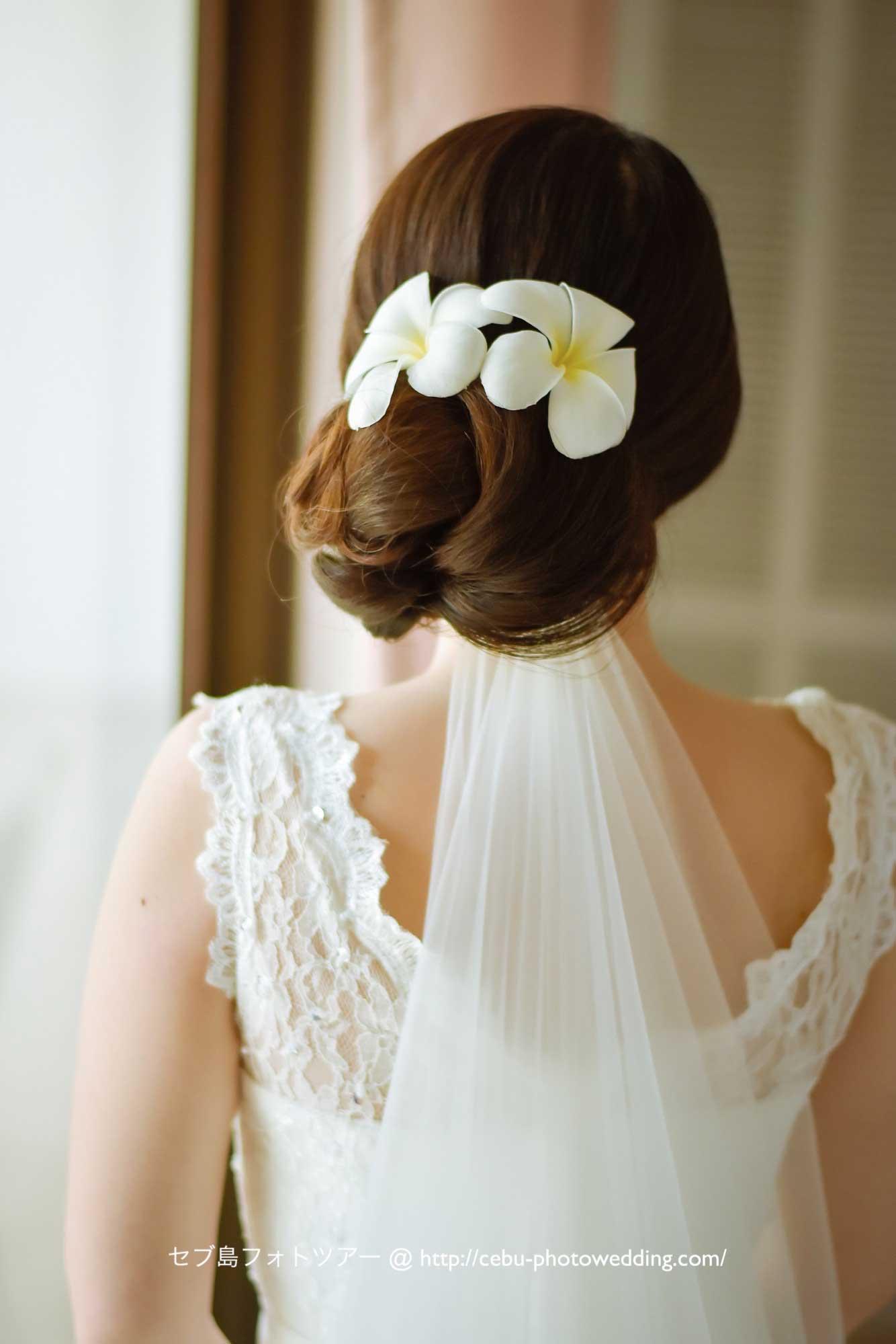 花嫁さまのヘアスタイルは気品あるツヤまとめ髪