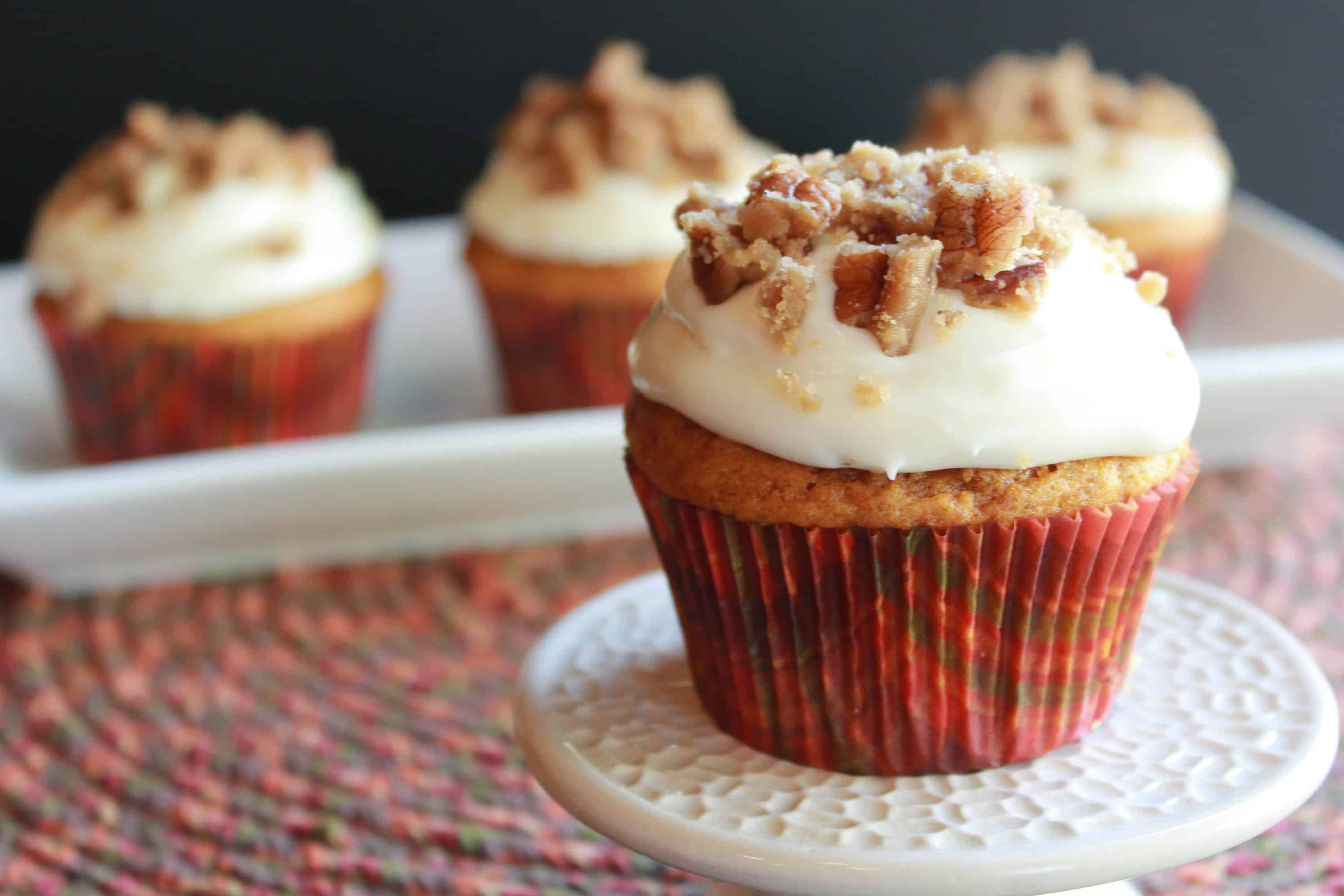 Pumpkin Cupcakes with Maple Cream Cheese Frosting | Celebrating Sweets