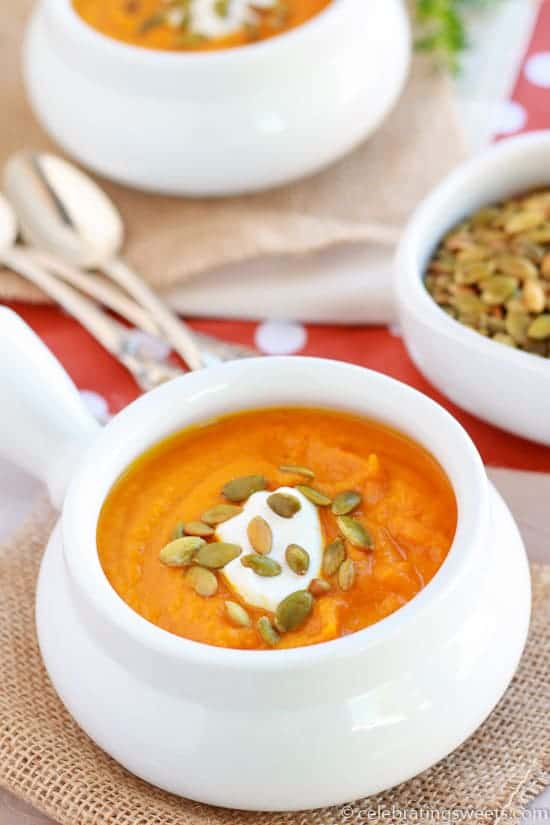 Roasted butternut squash and carrots combine with fresh thyme and bay leaf in this creamy Autumn soup. Warm, comforting and surprisingly healthy.