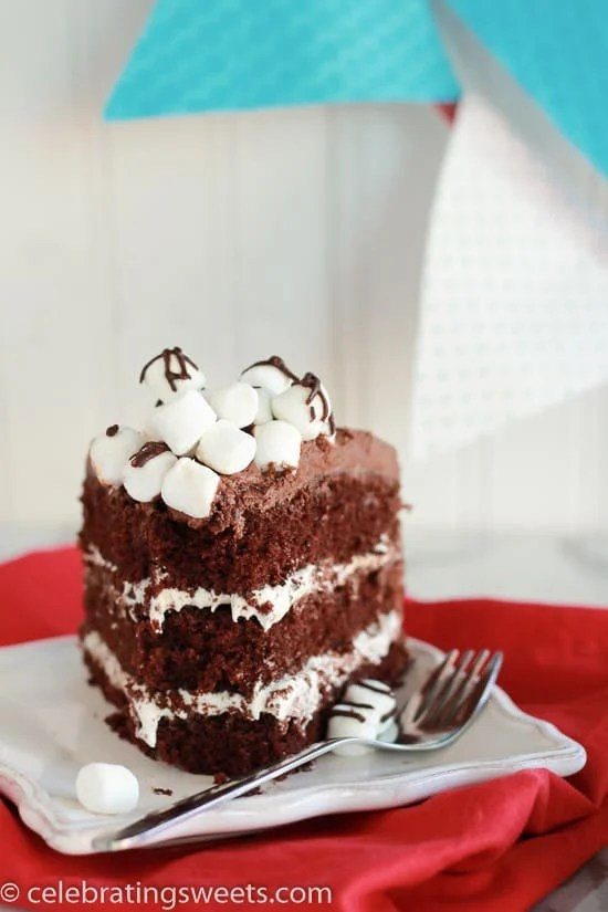 Chocolate Marshmallow Cake - Layers of chocolate cake, filled with marshmallow frosting, topped with chocolate frosting, and finished with a pile of marshmallows