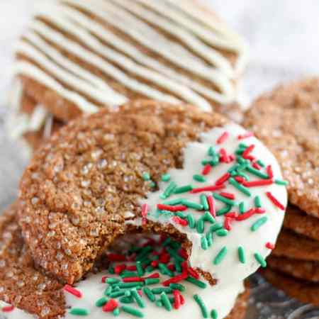 Big Chewy Ginger Molasses Cookies with a crunchy sugar coating and an optional white chocolate topping. These cookies are perfectly spiced and they stay chewy for days.