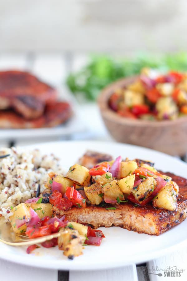Grilled Pork Chops with Pineapple Relish - Grilled pork chops coated in a sweet and smoky dry rub and served with a grilled pineapple relish. Ready in under 30 minutes!
