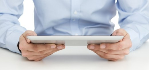 Close up of man reading at digital tablet