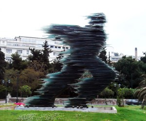 """The Runner"", public art scuplture in Athens by Costas Varotsos. Made of green glass with an internal structure of steel. Royalty-free image from stock.xchng by Lucretious"