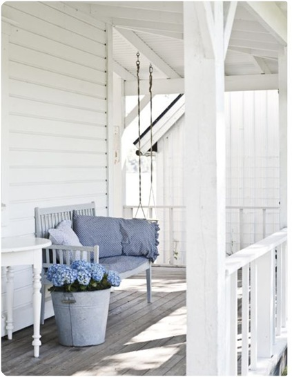 white porch blue hydrangeas