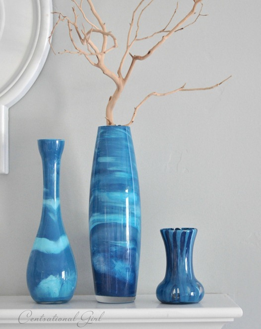 blue paint swirl vases on mantel