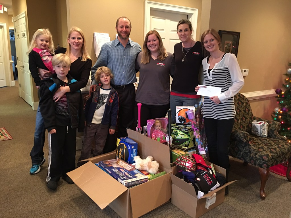 Moss Family Chiropractic delivered tons of toys and funds collected from their patients to our office on 12/21/15. They are pictured here with Brooke Larson, CFVC's Family Support Coordinator.