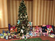 The elves from OneCoast collected Christmas Presents for our Children's Program during their 2016 National Sales & Training Meeting