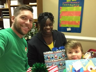 Some of the elves from Verizon Wireless North Alabama/North Georgia Sales Training Team: Josh Roberson, Senior Manager of training team and his son Aiden with CFVC Family Advocate, Lexi Kitchens