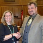 Chatham County Commission Chairman James Crawford congratulates Clerk to the Board of Commissioners Lindsay K. Ray for her achievement in earning the designation of North Carolina Certified County Clerk. The certification requires many hours of training and final exam through the School of Government at UNC-Chapel Hill.