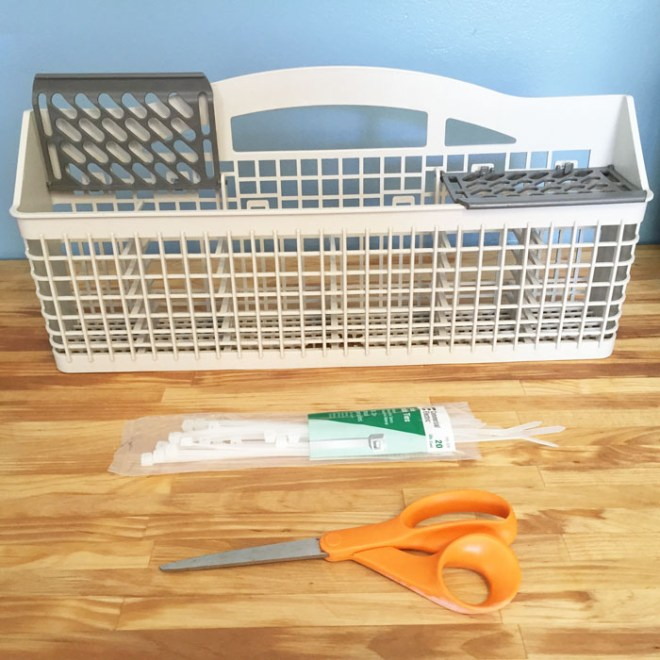 Quick Fix for a Broken Sliverware Tray: Image shows a broken dishwasher silverware basket and the zip ties used to fix it.