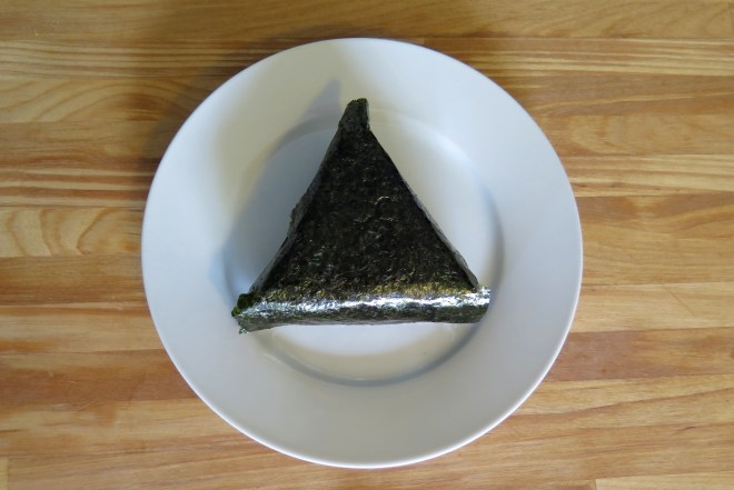 One piece of salmon onigiri on a plate.