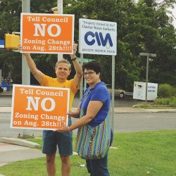 Dan and Cindy Gallo protest at the Chester Water Authority property.