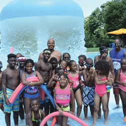 Chester Recreation Services Manager Duane Lee poses with a group of Chester children at the Memorial Park swimming pool. Photo by Loretta Rodgers